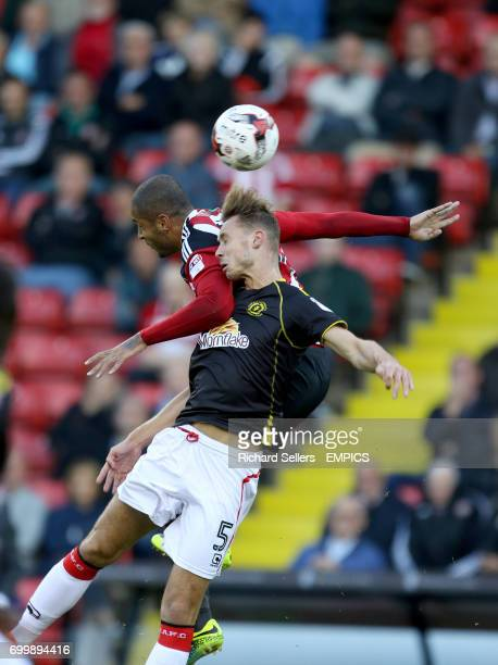 Sheffield United's Leon Clarke challenges Crewe Alexandra's George Ray in the air