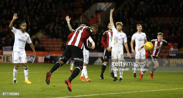 Sheffield United's Leon Clarke scores his side's fourth goal of the game during the Sky Bet Championship match at Bramall Lane Sheffield