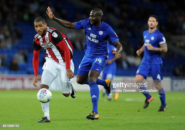 Sheffield United's Leon Clarke vies for possession with Cardiff City's Souleymane Bamba during the Sky Bet Championship match between Cardiff City...