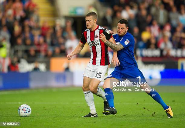 Sheffield United's Paul Coutts under pressure from Cardiff City's Lee Tomlin during the Sky Bet Championship match between Cardiff City and Sheffield...
