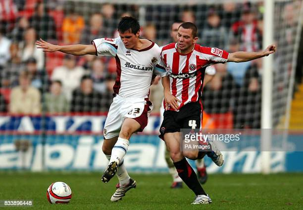 Sheffield United's Phil Bardsley and Burnley's Stephen Jordan in action during the CocaCola Football Championship match at Bramall Lane Sheffield