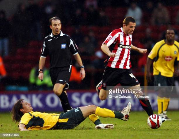 Sheffield United's Phil Bardsley and Plymouth Argyle's Lilian Nalis during the CocaCola Football League Championship match at Bramall Lane Sheffield
