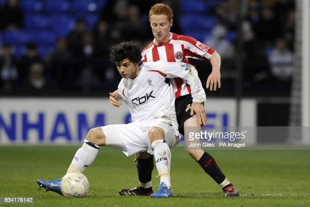 Sheffield United's Stephen Quinn battles for the ball with Bolton Wanderers' Blerim Dzemaili