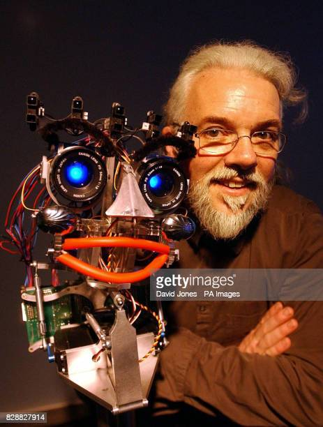 Sheffield University's Professor Noel Sharkey a world leading robotics expert and judge in TV's 'Robot Wars' with 'eMo' the robot The robot which...