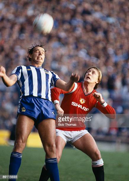 Sheffield Wednesday defender Mel Sterland with Manchester United's Peter Barnes during the match at Hillsborough in Sheffield 9th November 1985...