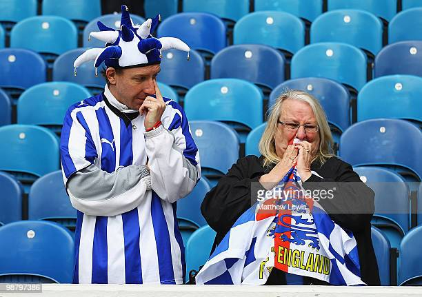 Sheffield Wednesday fans look on after their team was relegated to League One following their draw with Crystal Palace in the CocaCola Championship...