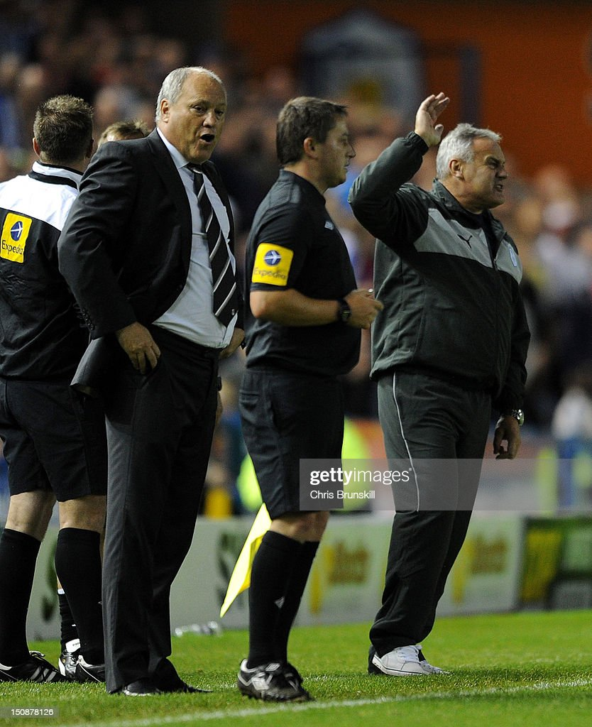 Sheffield Wednesday manager <a gi-track='captionPersonalityLinkClicked' href=/galleries/search?phrase=Dave+Jones+-+Football+Manager&family=editorial&specificpeople=4836218 ng-click='$event.stopPropagation()'>Dave Jones</a> reacts as Fulham manager <a gi-track='captionPersonalityLinkClicked' href=/galleries/search?phrase=Martin+Jol&family=editorial&specificpeople=215368 ng-click='$event.stopPropagation()'>Martin Jol</a> speaks to the assistant referee during the Capital One Cup Second Round match between Sheffield Wednesday and Fulham at Hillsborough Stadium on August 28, 2012 in Sheffield, England.