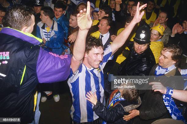 Sheffield Wednesday player David Hirst celebrates with fans after beating Chelsea in the Rumbelows League Cup semi final second leg at Hillsbrough on...