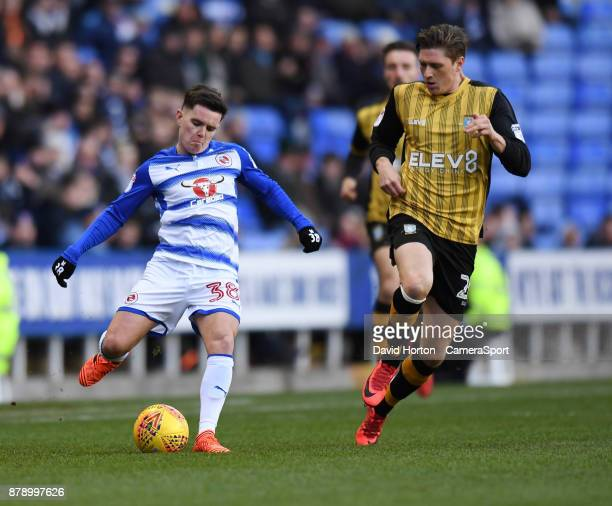 Sheffield Wednesday's Adam Reach vies for possession with Reading's Liam Kelly during the Sky Bet Championship match between Reading and Sheffield...