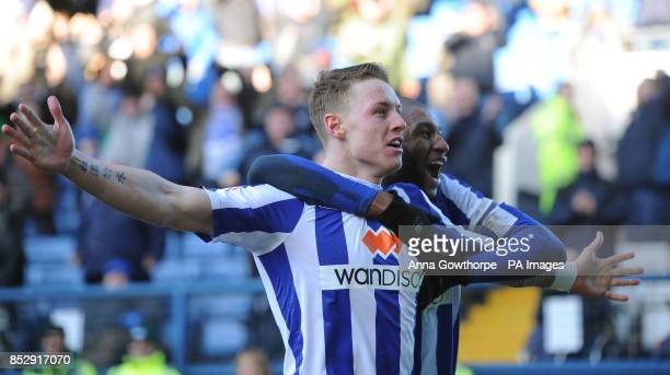 Sheffield Wednesday's Connor Wickham celebrates with Reda Johnson after scoring his side's third goal during the Sky Bet Championship match at...
