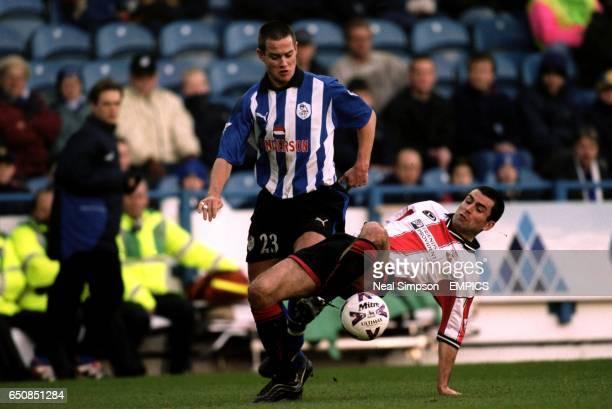 Sheffield Wednesday's Giles De Bilde tangles with Southampton's Francis Benali