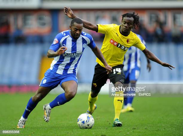 Sheffield Wednesday's Jacques Maghoma and Watford's Juan Carlos Paredes in action