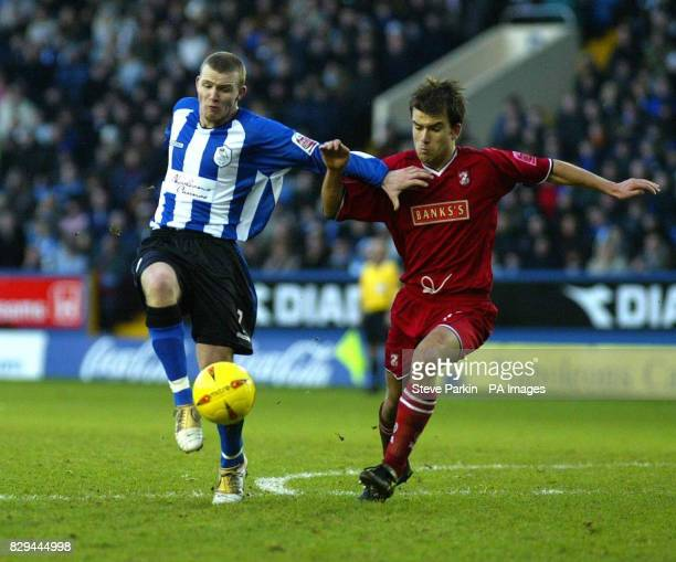 Sheffield Wednesday's Jon Paul McGovern battles for the ball with Walsall's Michael Standing