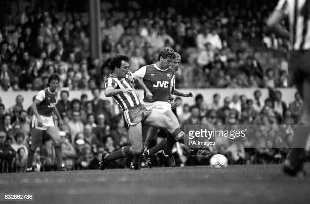 Sheffield Wednesday's Lawrie Madden in a midfield tussle with Arsenal's Tony Woodcock during the Canon League Division One clash between the two...
