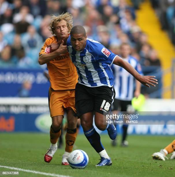 Sheffield Wednesday's Leon Clarke and Wolverhampton Wanderers' Michael Gray