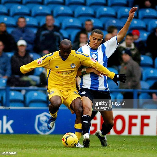 Sheffield Wednesday's Madgid Bougherra and Leicester City's Elvis Hammond in action during the CocaCola League Championship match at Hillsborough...