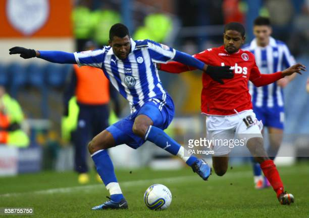 Sheffield Wednesday's Reda Johnson and Charlton Athletic's Bradley Pritchard during the npower League One match at Hillsborough Sheffiled