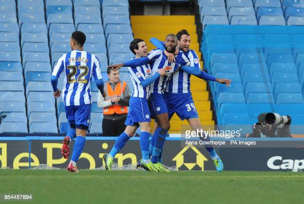 Sheffield Wednesday's Reda Johnson celebrates after scoring the opening goal during the Sky Bet Championship match at Hillsborough Sheffield