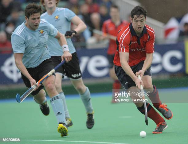 Sheffield's Phil Roper gets away from Cardiff UWIC's Danny Deveney during their NOW Pensions Men's Hockey League Playoff match at Sonning Lane Reading