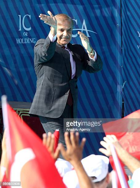 Shehbaz Sharif the Chief Minister of Punjab greets people as they attend the opening ceremony of newly constructed Yavuz Sultan Selim Bridge today in...