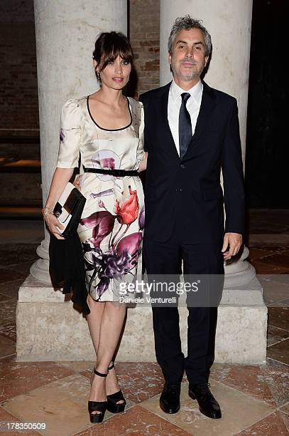 Sheherazade Goldsmith and Alfonso Cuaron attend the Miu Miu Women's Tales dinner hosted by Miuccia Prada at the Ca' Corner on August 29 2013 in...