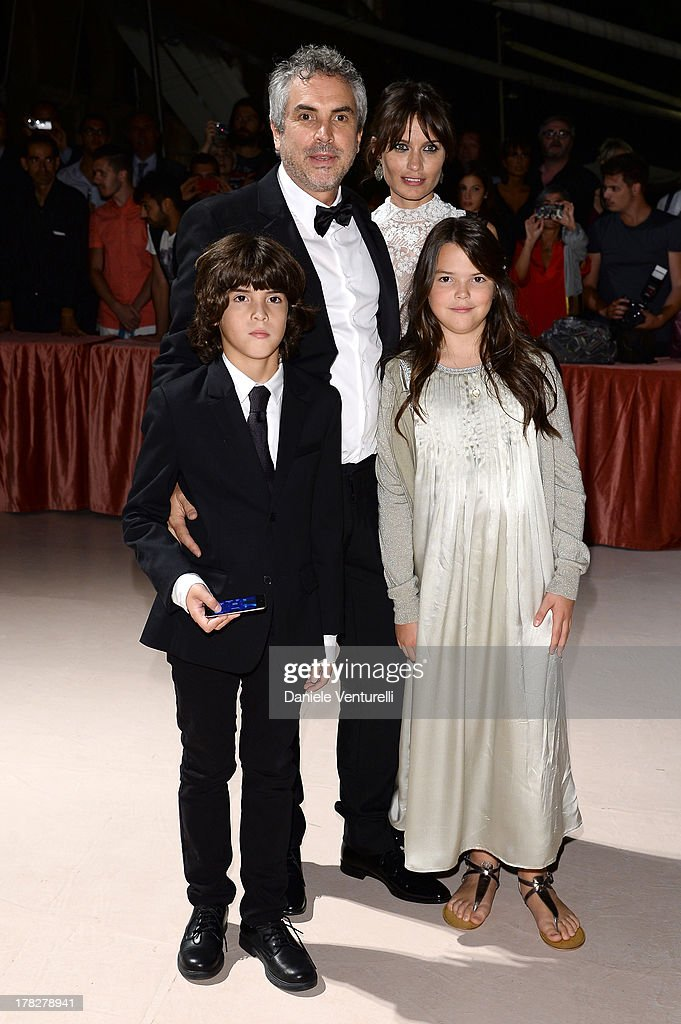 Sheherazade Goldsmith and director Alfonso Cuaron attend the Opening Ceremony during The 70th Venice International Film Festival on August 28, 2013 in Venice, Italy.