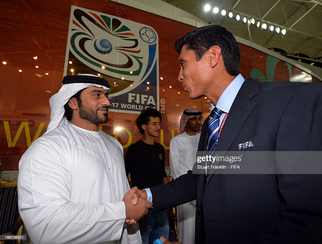 Sheiek Abdullah Bin Mohamed Bin Khalid Alinhayah welcomes Eddie Morales of FIFA during the round of 16 match between Nigeria and Iran at Khalifa Bin Zayed Stadium on October 29, 2013 in Al Ain, United Arab Emirates.