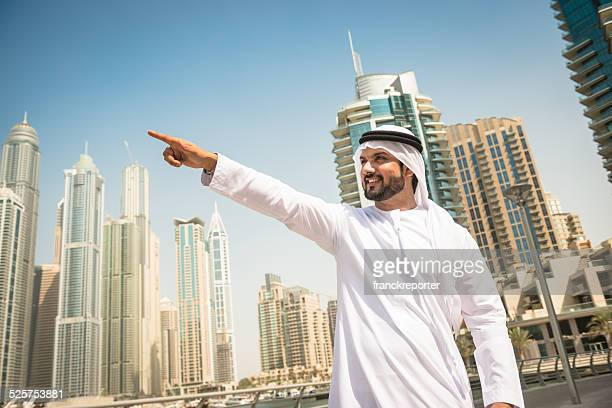 sheik aiming something in dubai marina