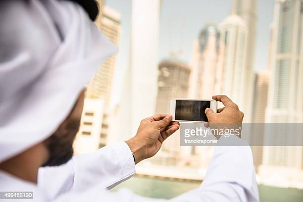 sheik doing a selfie on dubai marina