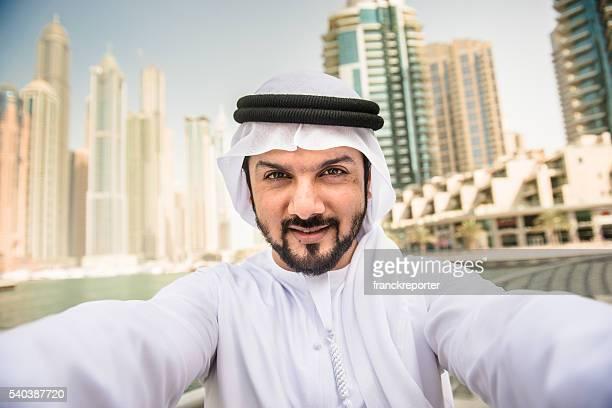 sheik doing a selfie on dubai marina
