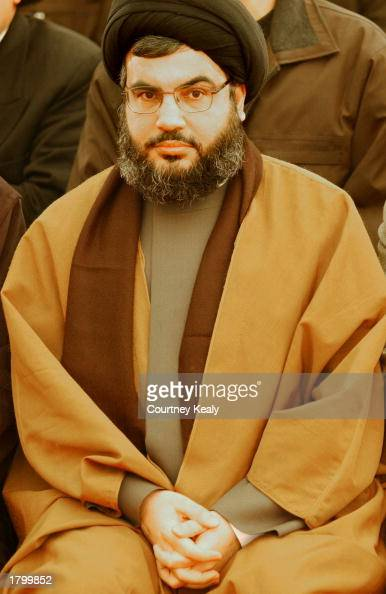 Sheik Nasrallah Hebollah's Secretary General waits before he gives a speech February 16 2003 in Nabi Chit Lebanon The speech and rally commemorate...