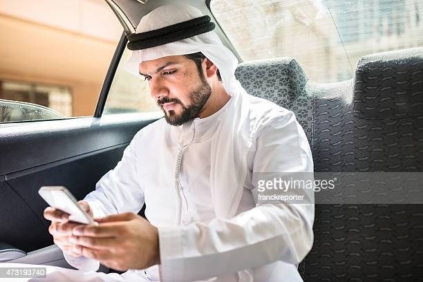 sheik on the phone inside a taxi