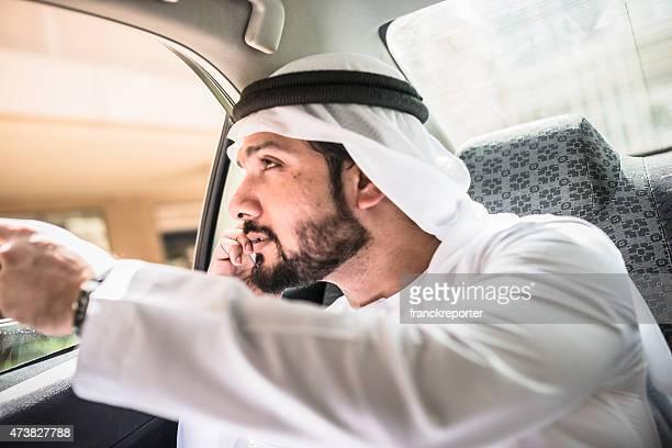 sheik on the phone inside a taxi