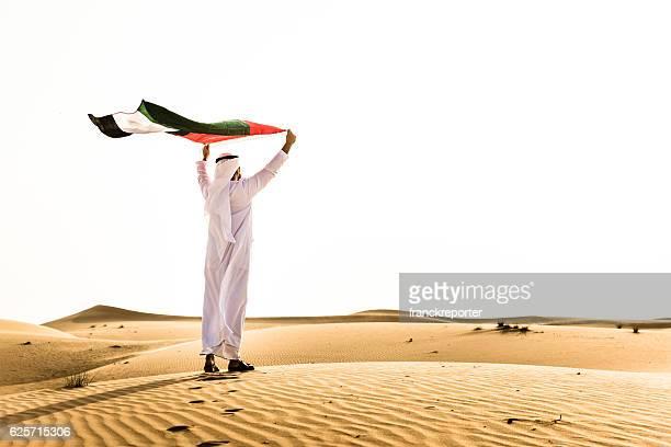 Sheik waving the uae flag for national day