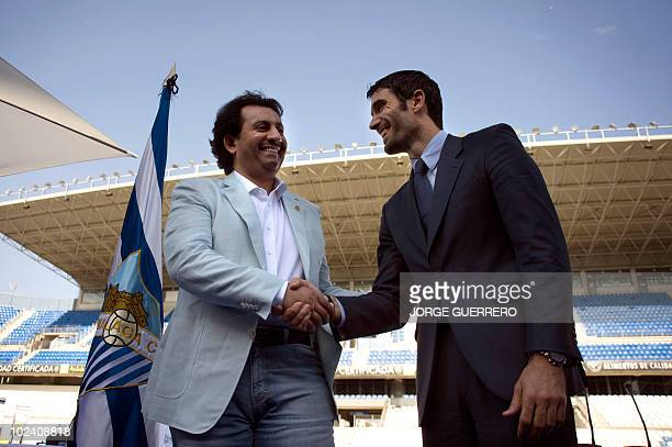 Sheikh Abdallah Ben Nasser AlThani a member of the Qatari ruling family shakes hands with the President of Malaga football club Fernando Sanz during...