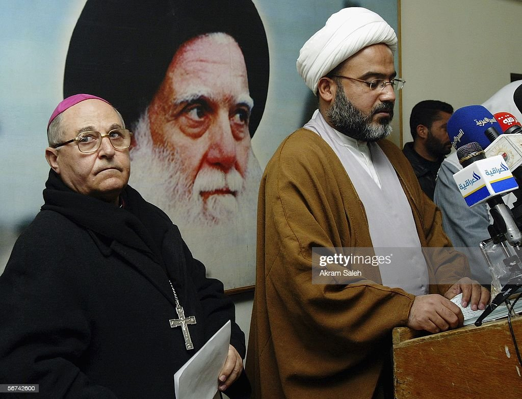 Sheikh Abdul-Hadi al-Daraji (R), spokesman for Muslim Shiite cleric Moqtada Sadr speaks during a press conference as Christian priest Shleimon Wardoni (L) looks on, February 4, 2006 in the Sadr City neighborhood of Baghdad, Iraq. Clerics from various religious and ethnic groups held a press conference in Baghdad in which they condemned the publication of anti-Prophet Muhammad cartoons by a daily Danish publications and attacks against Christian churches in Iraq.