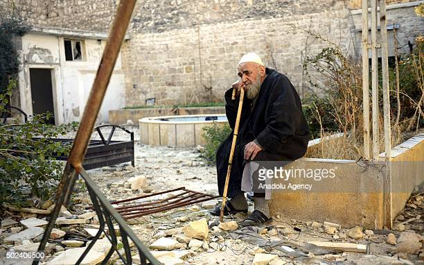 Sheikh Abdulhalik Shamiyye a secondhand book seller who has been doing this job for more than 50 years sits in front of his demolished house in...