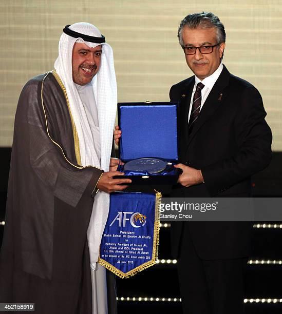 Sheikh Ahmed AlFahad AlAhmed AlSabah President of the Olympic Council of Asia receives a momentum from AFC President Shaikh Salman bin Ebrahim Al...