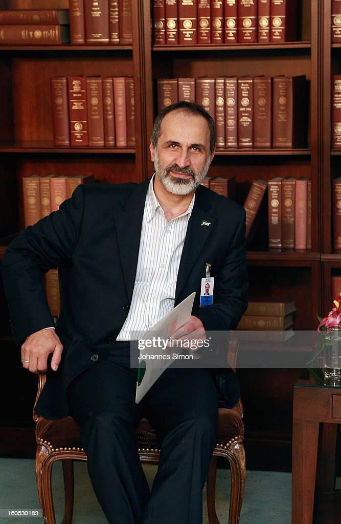 Sheikh Ahmed Moaz Al-Khatib, President of the National Coalition for Opposition Forces and the Syrian Revolution poses ahead of a bilateral meeting with U.S. vice president Joe Biden at Hotel Bayerischer Hof on February 2, 2013 in Munich, Germany. The Munich Security Conference brings together senior figures from around the world to engage in an intensive debate on current and future security challenges and remains the most important independent forum for the exchange of views by international security policy decision-makers.