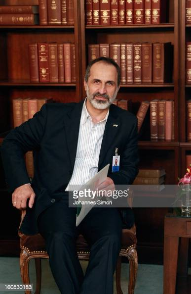 Sheikh Ahmed Moaz AlKhatib President of the National Coalition for Opposition Forces and the Syrian Revolution poses ahead of a bilateral meeting...
