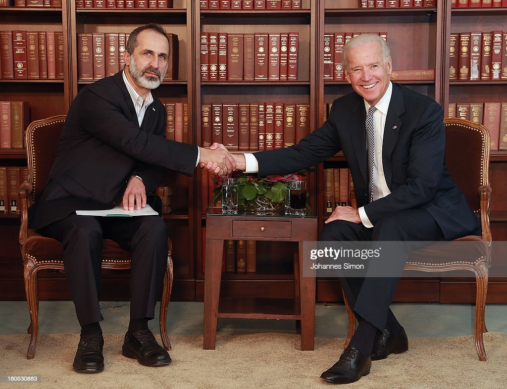 Sheikh Ahmed Moaz Al-Khatib (L), President of the National Coalition for Opposition Forces and the Syrian Revolution and U.S. vice president Joe Biden pose ahead of a bilateral meeting at Hotel Bayerischer Hof on February 2, 2013 in Munich, Germany. The Munich Security Conference brings together senior figures from around the world to engage in an intensive debate on current and future security challenges and remains the most important independent forum for the exchange of views by international security policy decision-makers.