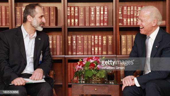 Sheikh Ahmed Moaz AlKhatib President of the National Coalition for Opposition Forces and the Syrian Revolution and US vice president Joe Biden pose...