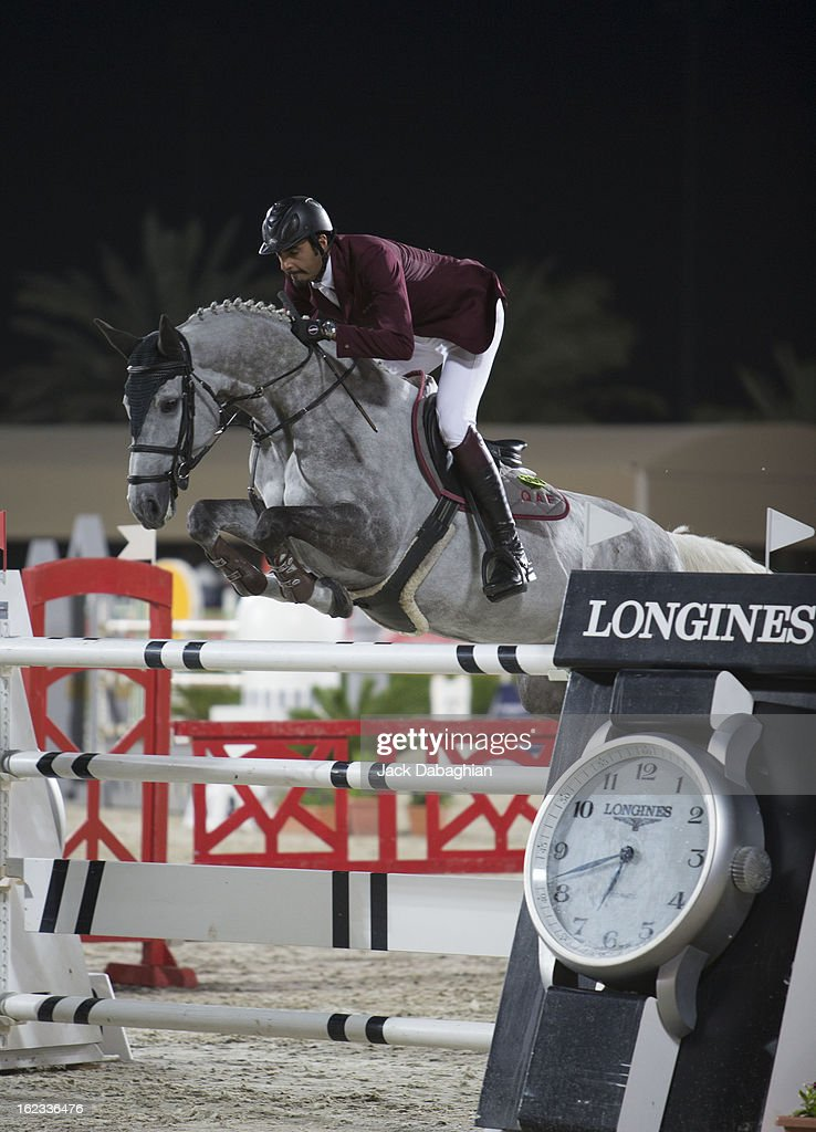 Sheikh Ali Bin Khalid AL Thani of Qatar clears a hurdle on Eurocommerce California during the President of the UAE Showjumping Cup - Furusyiah Nations Cup Series presented by Longines on February 21, 2013 in Al Ain, United Arab Emirates.