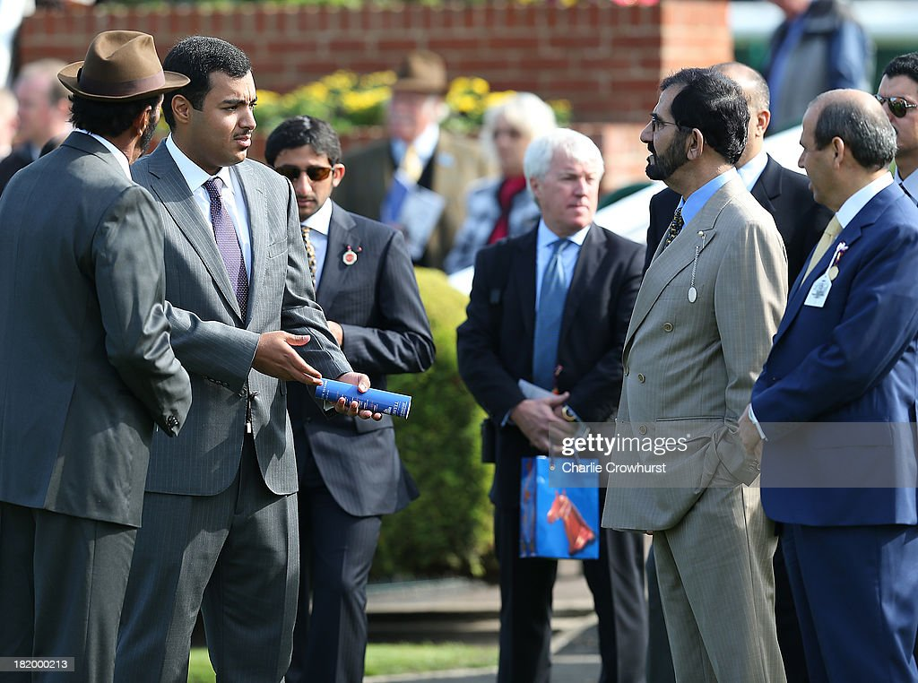 Sheikh Fahad Al Thani (L) of QIPCO chats with Sheikh Mohammed Bin Rashid Al Maktoum (R) at Newmarket racecourse on September 27, 2013 in Newmarket, England.