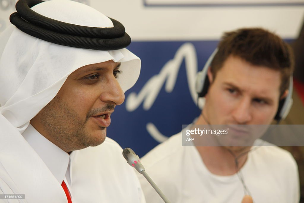 Sheikh Faisal Bin Ahmad Al Thani (L), supervisor of Qatar's Aspire academy, gives a press conference with Argentinian football star Lionel Messi on June 27, 2013 in Mbour, as part of a humanitarian visit to Senegal. Barcelona star Lionel Messi flew into in Senegal on June 27 to distribute mosquito nets in a bid to reduce outbreaks of deadly malaria.