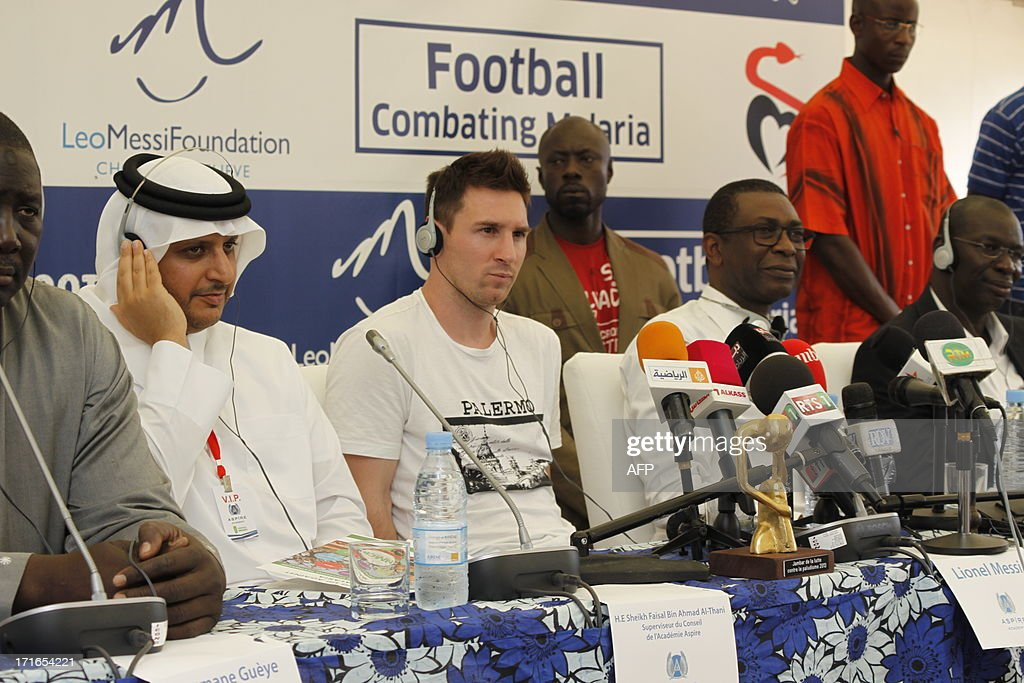 Sheikh Faisal Bin Ahmad Al Thani (2nd L), supervisor of Qatar's Aspire academy, attends a press conference with Argentinian football star Lionel Messi (3rd L) on June 27, 2013 in Mbour, as part of a humanitarian visit to Senegal. Barcelona star Lionel Messi flew into in Senegal on June 27 to distribute mosquito nets in a bid to reduce outbreaks of deadly malaria.