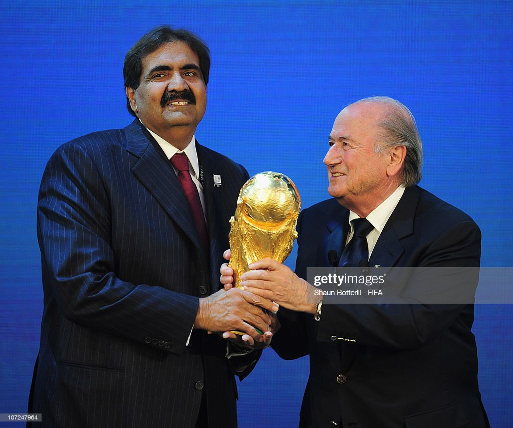 Sheikh Hamad bin Khalifa Al Thani receives the trophy from FIFA President Joseph S Blatter after the annoucement that Qatar had won the bid for the...