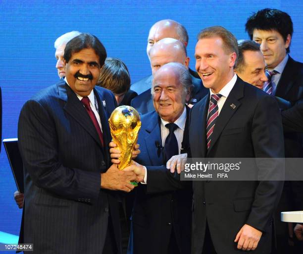Sheikh Hamad bin Khalifa AlThani the Emir of Qatar and Deputy Russia Prime Minister Igor Shuvalov hold the FIFA World Cup trophy with FIFA President...