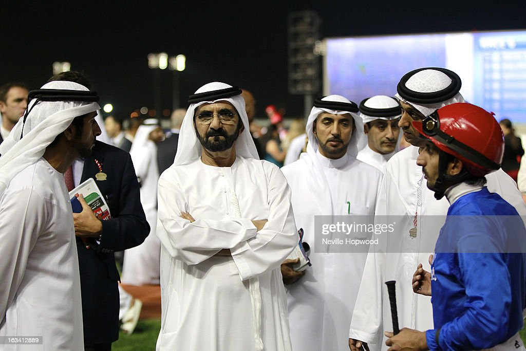 Sheikh Hamdan Al Makoum (L) talks with Sheikh Mohammed Al Maktoum as Godolphin Trainer Mahmoud Al Zarooni and Jockey Ahmad Ajtebi listen during Super Saturday at Meydan Racecourse on March 9, 2013 in Dubai, United Arab Emirates.