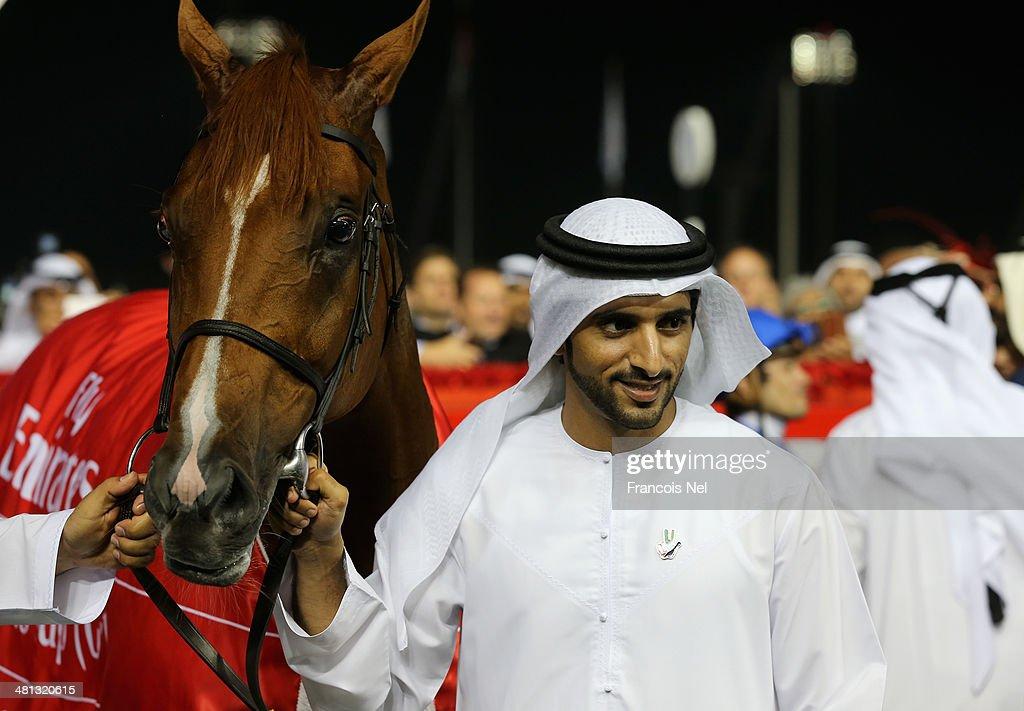 Sheikh Hamdan bin Mohammed bin Rashid Al Maktoum Crown Prince of Dubai celebrates after winning the Dubai World Cup at the Meydan Racecourse on March 29, 2014 in Dubai, United Arab Emirates.